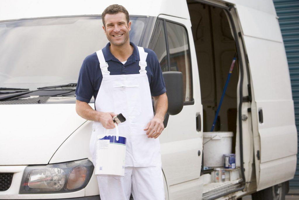 man smiling posing outside van