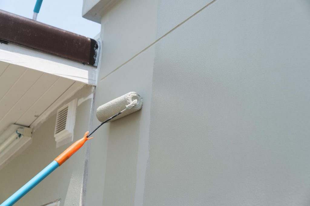 paint roller rolling on wall