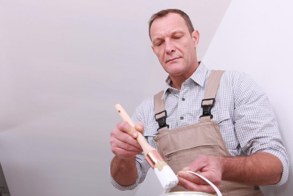 painter doing commercial painting