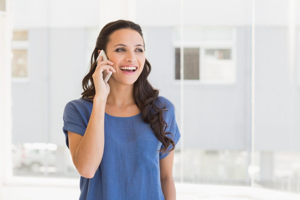 smiling woman answering call
