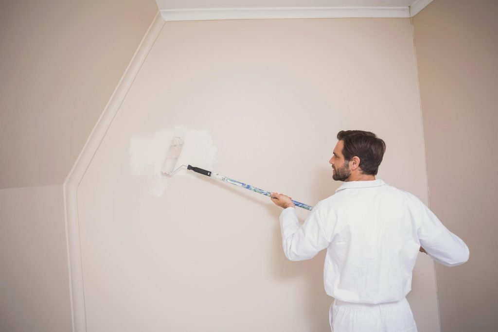 painter doing interior painting