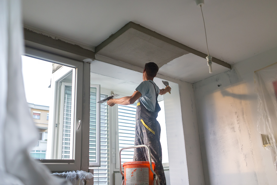 painter doing interior home painting
