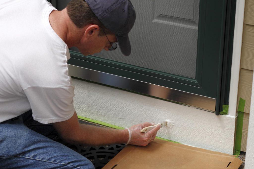 painter doing door painting