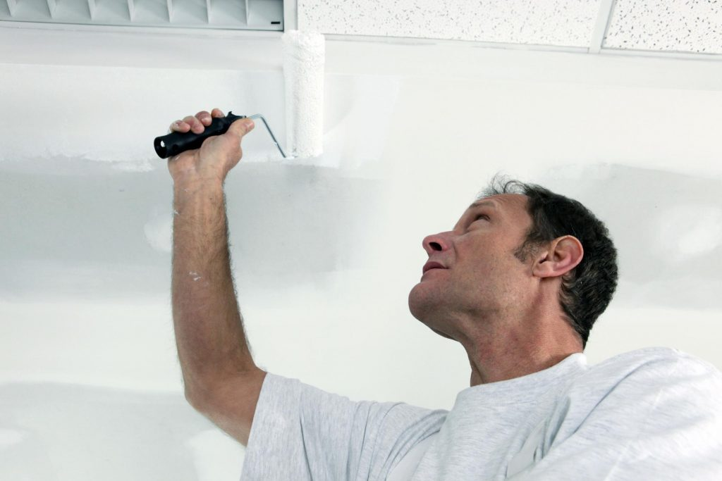 painter doing ceiling painting